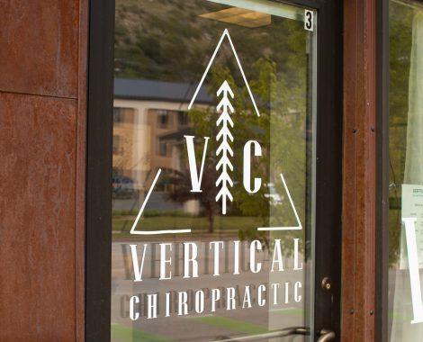 front office on 550, durango co, chiropractic logo, branding, glass door, southwest co